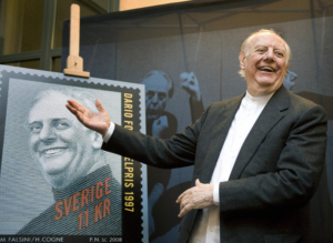 Italian 1997 Nobel literature prize winner Dario Fo reacts while unveiling a commemorative postage stamp in Stockholm on November 13, 2008. Since 1961, the Swedish Mail have issued stamps honouring past Nobel prizewinners. AFP PHOTO / SCANPIX SWEDEN / Anders Wiklund (Photo credit should read ANDERS WIKLUND/AFP/Getty Images)
